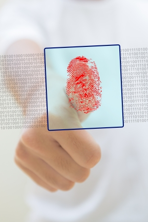 private access: Close-up of thumb with a red fingerprint, security concept Stock Photo