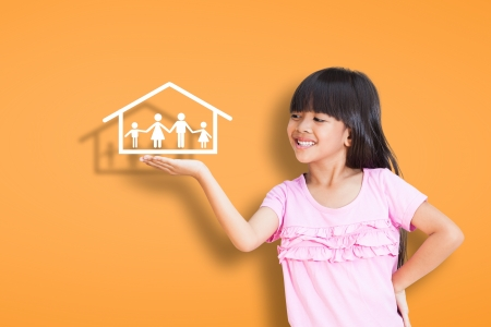 home garden: Smiling little girl showing on family symbol over simply background