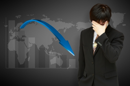 market crash: Stressed businessman with low financial graph of global business Stock Photo