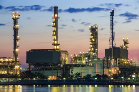 pollutant: Refinery plant area at twilight with reflection in river