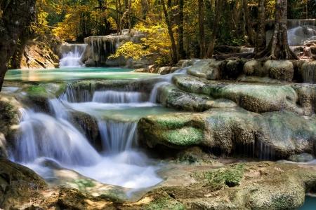 boulder: Mountain stream among the mossy stones, Erawan waterfall, Thailand Stock Photo