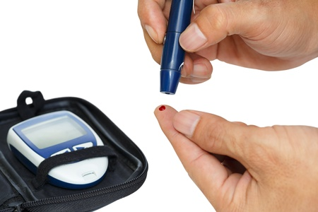 finger tip: Diabetic lancet device in hand, Isolated over white Stock Photo