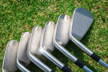 Golf equipment on green grass photo