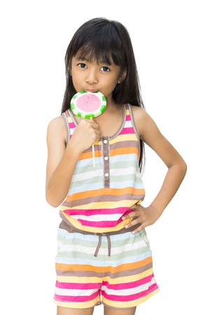 Asian girl with lollipop ,Isolated over white photo