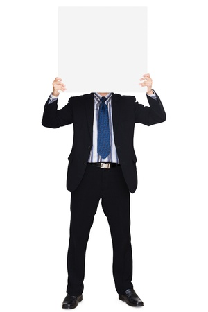 Business man in dark suit holding a blank sign, Isolated over white background photo