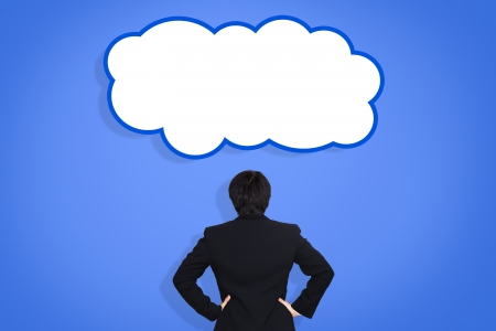 Businessman with think cloud photo