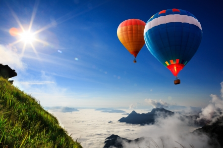 weather balloon: Colorful hot-air balloons flying over the mountain Stock Photo