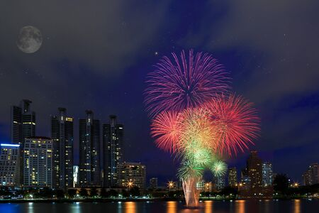 Fireworks over building cityscape, Bangkok Thailand photo