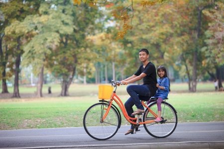 Brother and sister cycling bicycle at the park, Outdoor Portrait photo