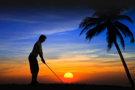 Silhouette golfer at sunset photo