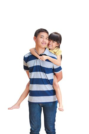 Teenager boy giving little girl  piggyback ride,  Isolated on white photo