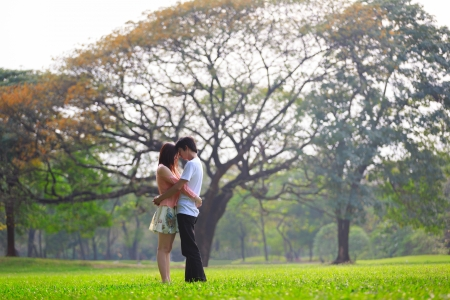 Portrait of a young romantic couple embracing, Outdoor portrait photo