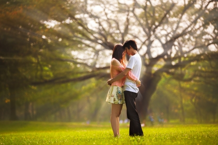 Portrait of a young romantic couple embracing, Outdoor portrait Stock Photo