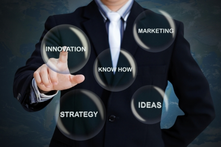 group strategy: Businessman pressing modern social buttons on a virtual background Stock Photo