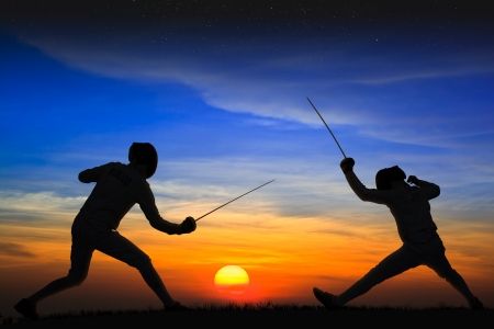 fencers: Silhouette fencers with sunset