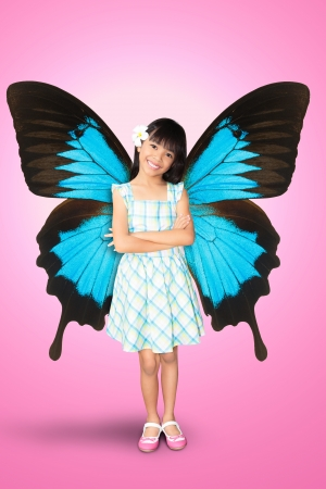 Little girl with butterfly wings photo