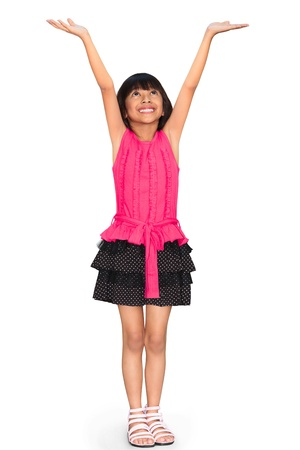 Asian little girl standing and holds hands up, Isolated over white with clipping path photo