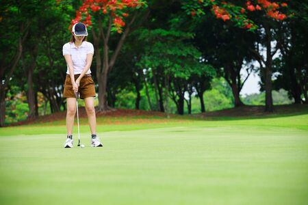 Golf woman player green putting photo