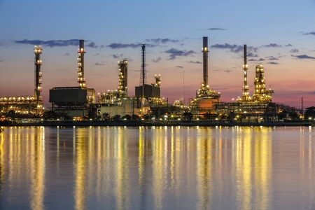 Refinery plant area at twilight with reflection photo