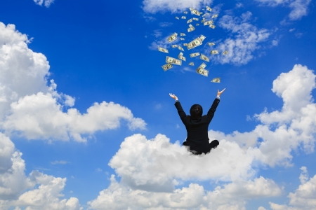 win money: Young businessman sitting on the cloud with a lot of falling dollars Stock Photo