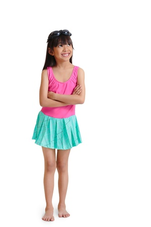 Little asian girl wearing swimsuit look up empty space, Isolated over white with clipping path photo