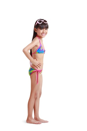 two piece swimsuits: Little asian girl wearing swimsuit, Isolated over white