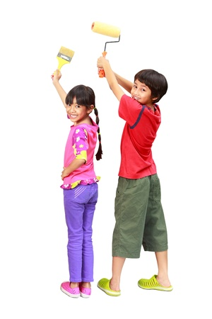 hand painting: Little painters two kids in coveralls with paint rollers rear view, Isolated on white with clipping path
