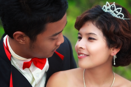 Loving asian couple faces in closeup photo