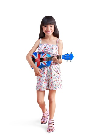 Little asian girl playing ukulele, Isolated over white with clipping path photo