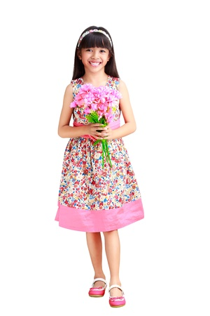 Beautiful young asian girl in a dress with a flower in her hand, Isolated over white with clipping path Stock Photo - 20934146