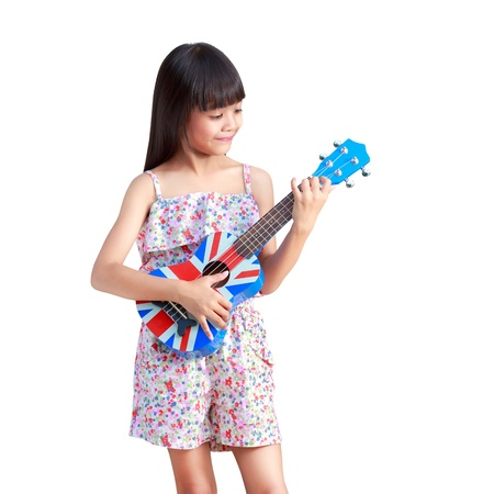 playing music: Little asian girl playing ukulele, Isolated over white with clipping path