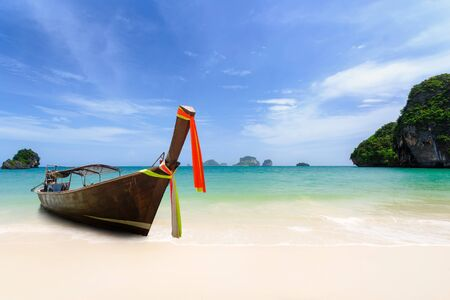 Long boat at beach, Thailand photo