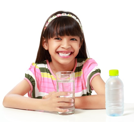 female kid: Young asian girl with a-glass of water, Isolated over white Stock Photo