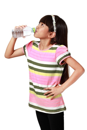 Little asian girl drinking mineral water bottle, Isolated over white with clipping path photo