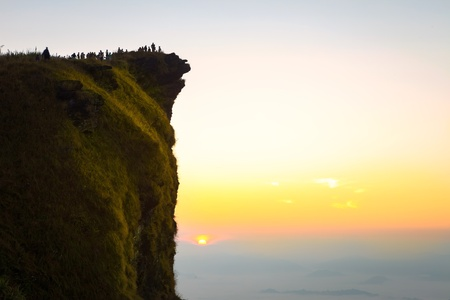 Group of people on top of a mountain at phu cheefa at Chiangrai, Thailand photo