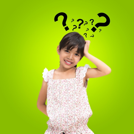 Thinking little girl with question mark photo