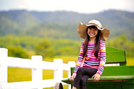 Smiling little asian girl photo