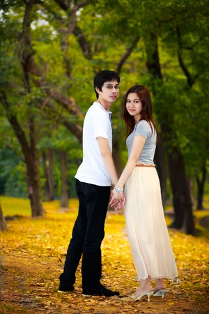 Portrait of young asian couple in a park photo