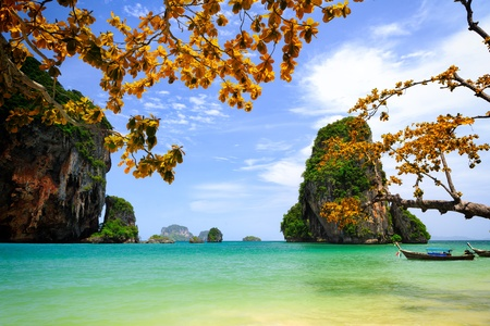 Tropical beach with limestone rock, Krabi, Thailand photo