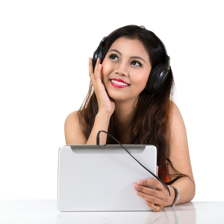 Young asian woman with headphones, Isolated over white photo