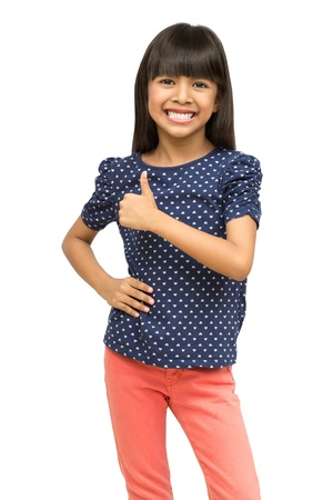 Young asian girl showing thumb up, Isolated over white  photo