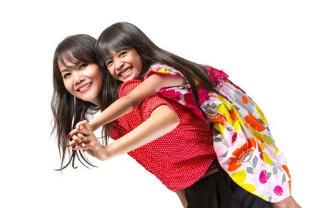 piggyback: Happy mother and daughter playing, Isolated over white