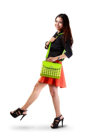 Young asian woman holding handbag photo