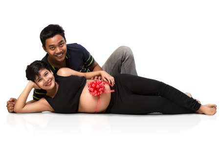 Pregnant couple laying photo
