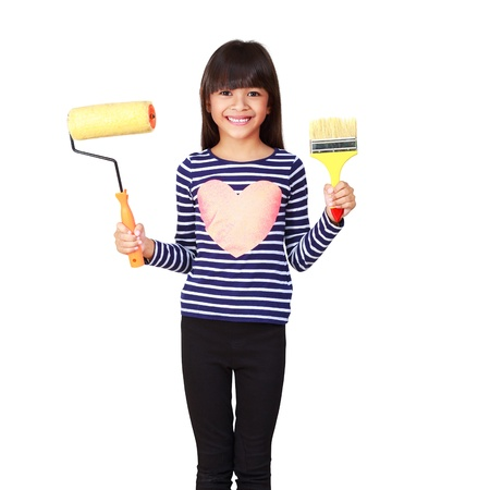 Little asian girl with paint brush and roller in hand photo