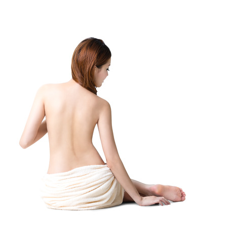 Asian woman wearing towel sitting on the floor back view photo