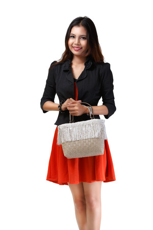Young asian woman holding handbag Stock Photo - 22418709