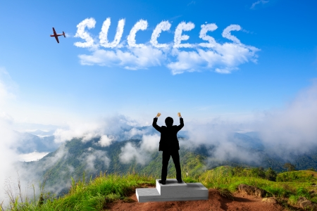 success business: Businessman standing on a winner podium at the mountains, Success in business concept