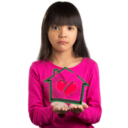 Sadness little asian girl holding virtual house with broken heart, Broken family concept photo