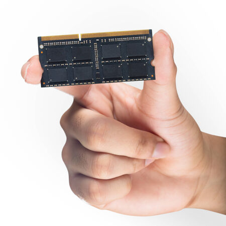 Hand holding computer memory DDR3 photo
